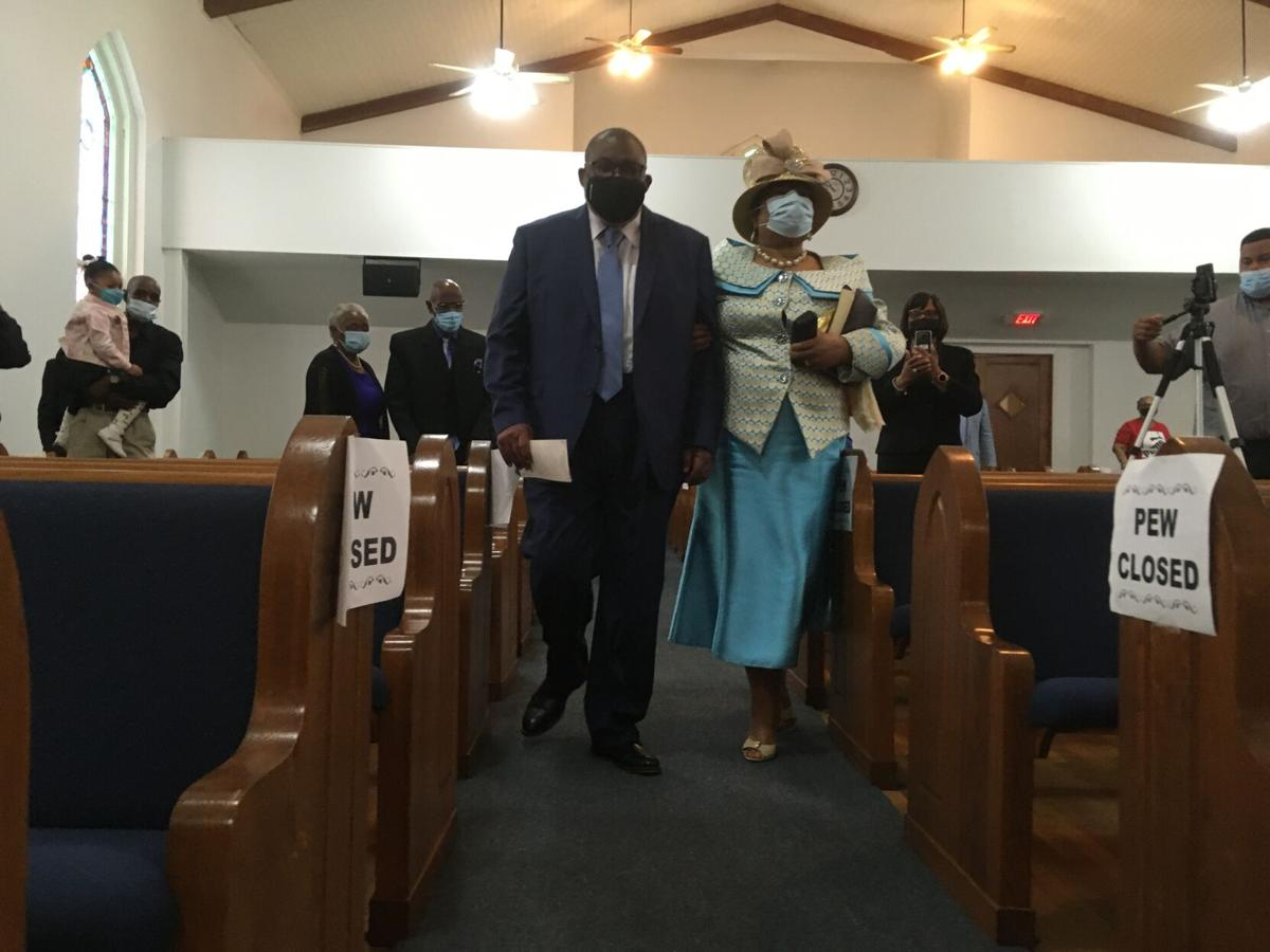 The Rev. Gregory O'Keith Wyatt and Elaine Wyatt enter the church during a service honoring them on March 14.