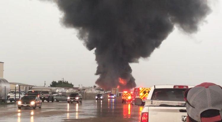 Lightning strikes tanker, ignites fire