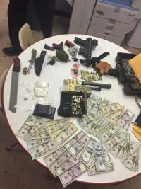 Police: Marijuana plants, drugs, money, guns seized from