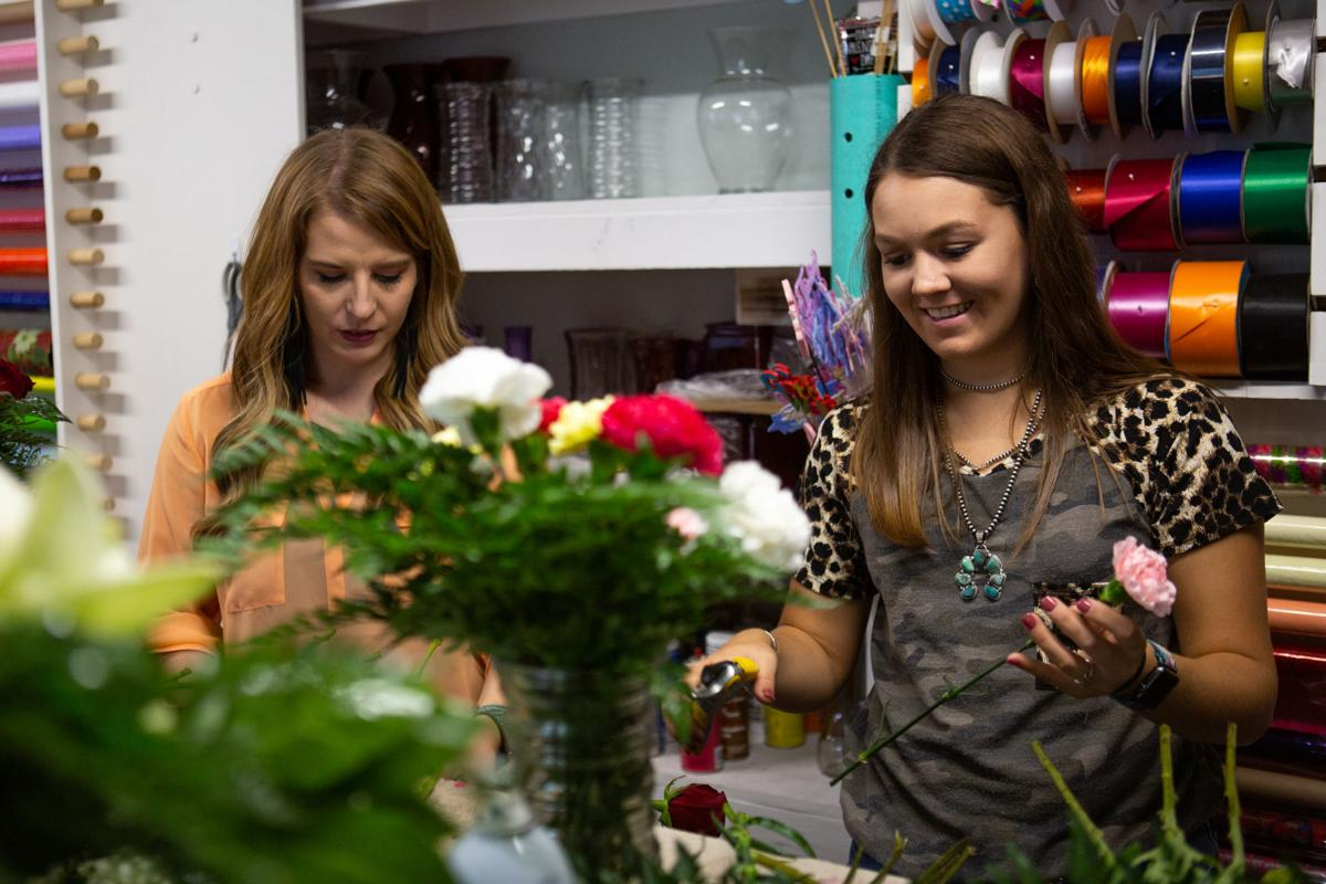 Shelby Slover working at Goliad Flower Company