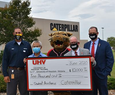 Officials from Caterpillar Victoria and UHV pose in June outside the Caterpillar Victoria facility.