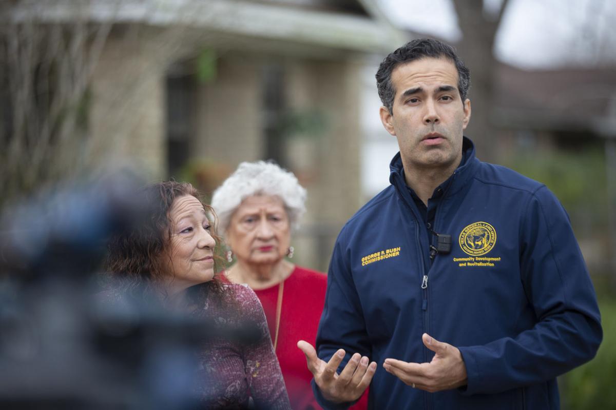 Bush tours Harvey-damaged home