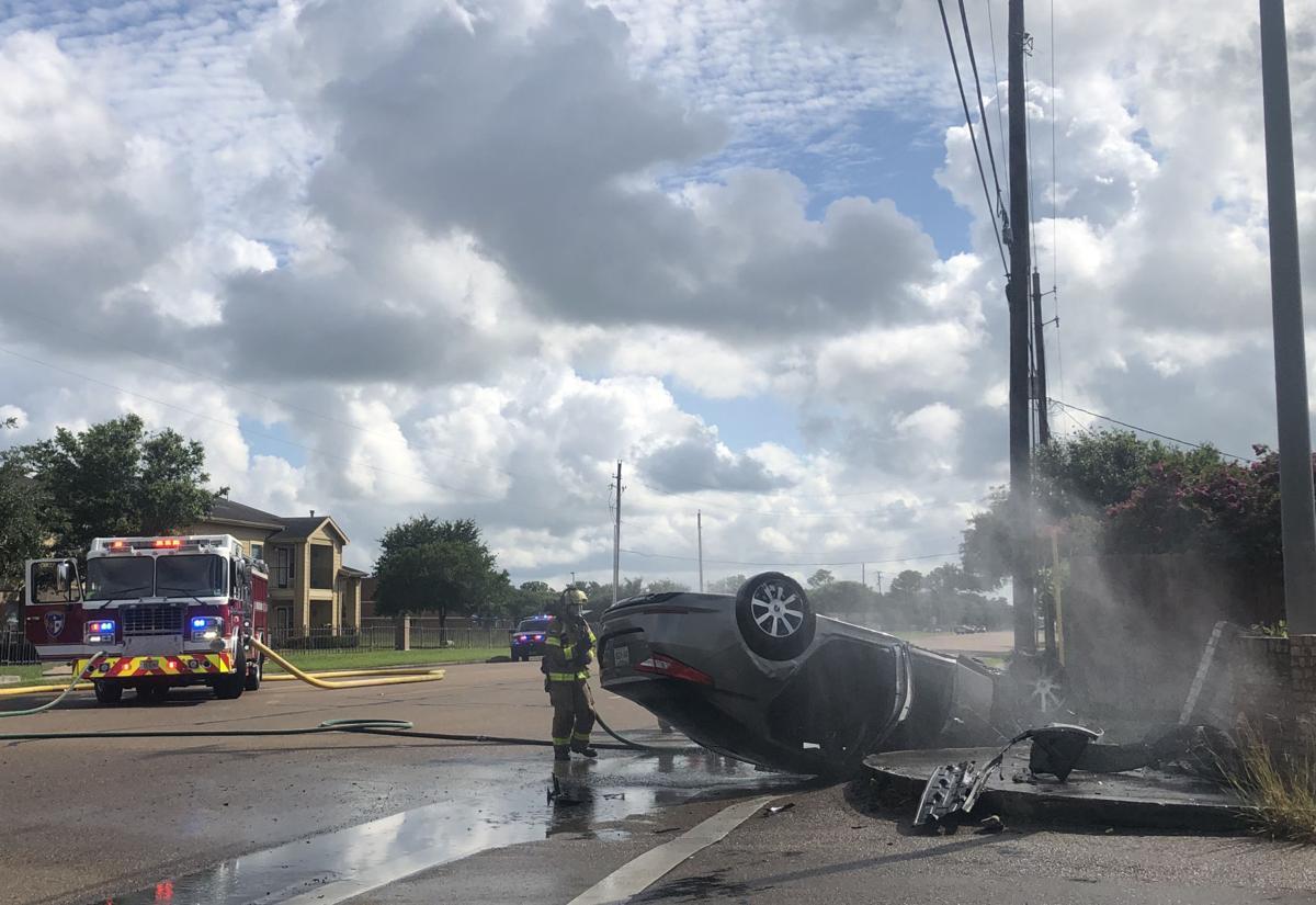 Car flips on Salem Road