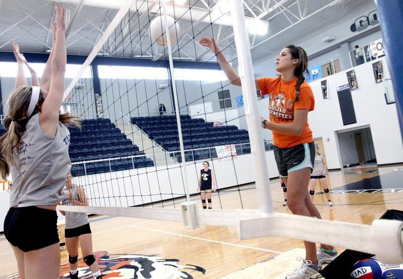 Former Tigerette leads volleyball team
