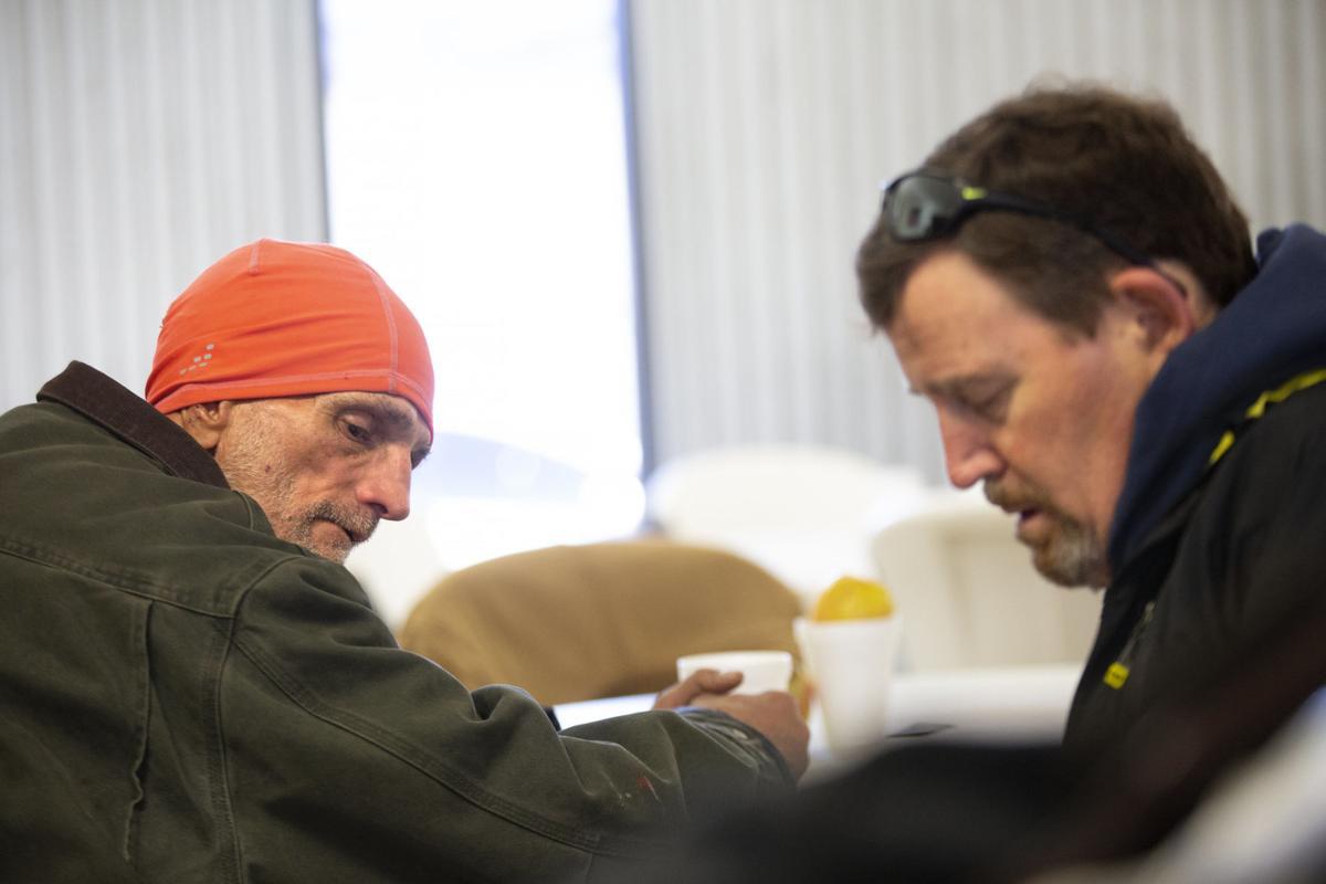Volunteers work to count, help homeless population