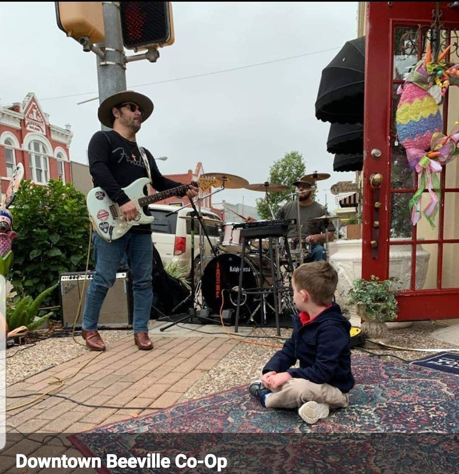 Henry Bethune listens to the Tony Rodriguez Band outside of Wicker Basket during one of the Spring Stroll sessions in downtown Beeville.
