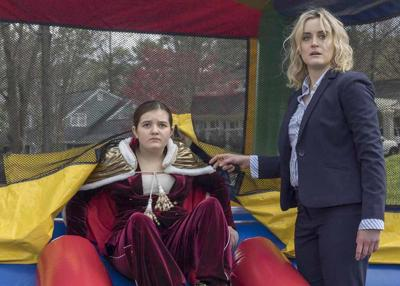Bryn Vale and Taylor Schilling in a scene from 'Family'