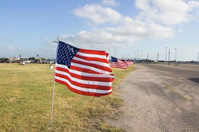 Flags line the road at a past Miller Lite Blastoff July 4th Celebration at the Victoria Community Center.