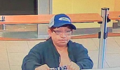Cameras capture woman suspected of robbing Edna bank
