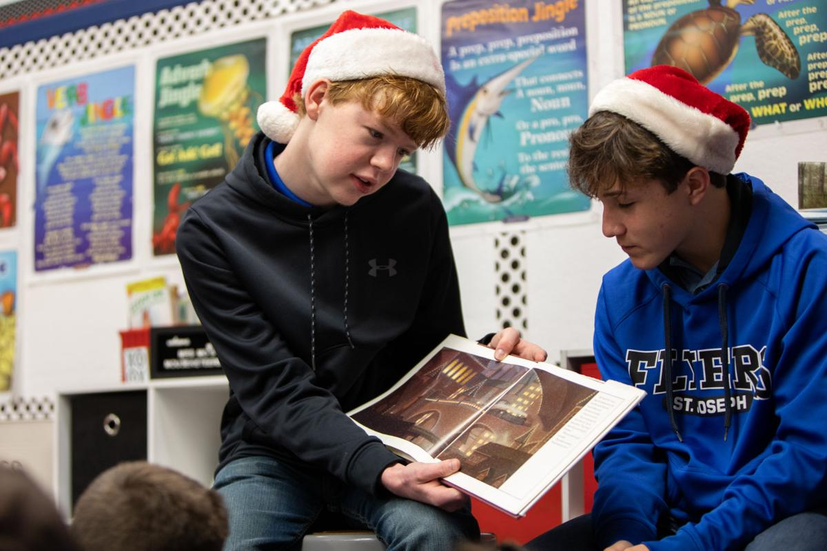 St. Joseph students read Christmas stories to lower-level private schools