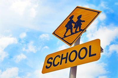 Generic school: students crossing sign