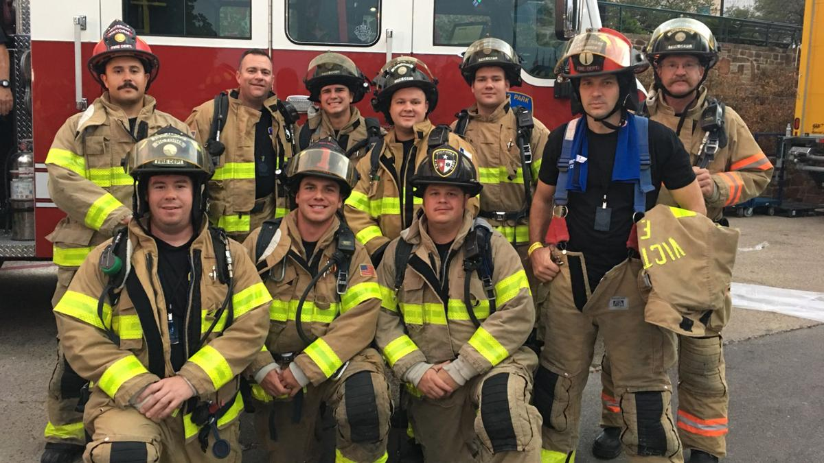 Victoria fire department members who climbed the Tower of Americas