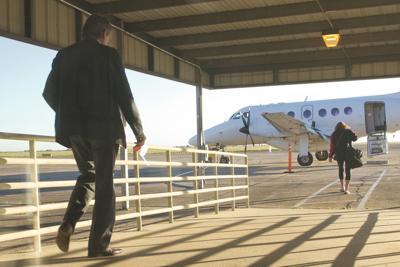 Airport passengers board flight to Dallas