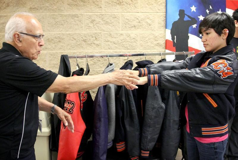 victoria east students try on letterman jacket legacy