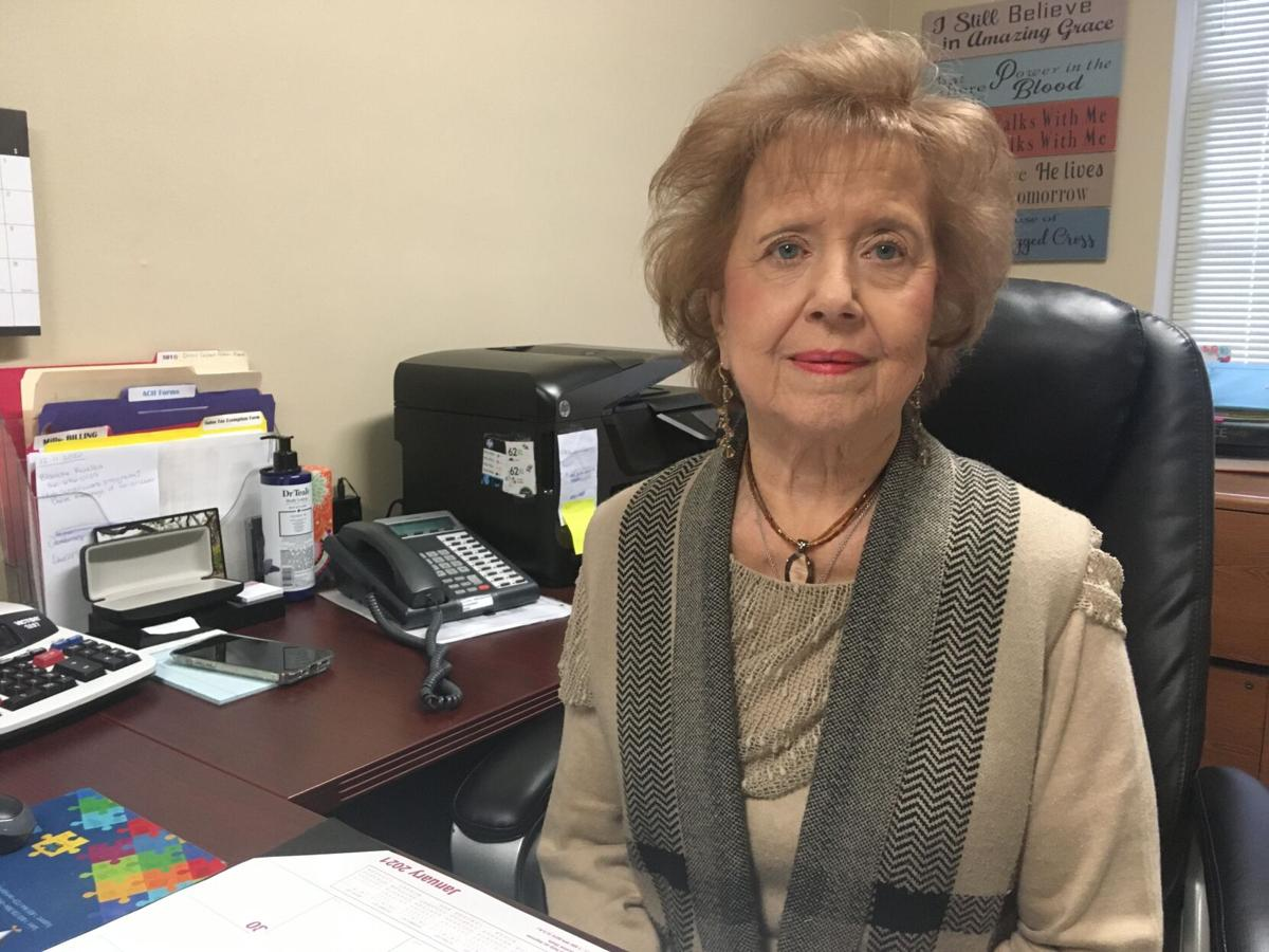 Nearlie Cooley poses for a photograph in her old office at First Baptist Church Day Care Center.
