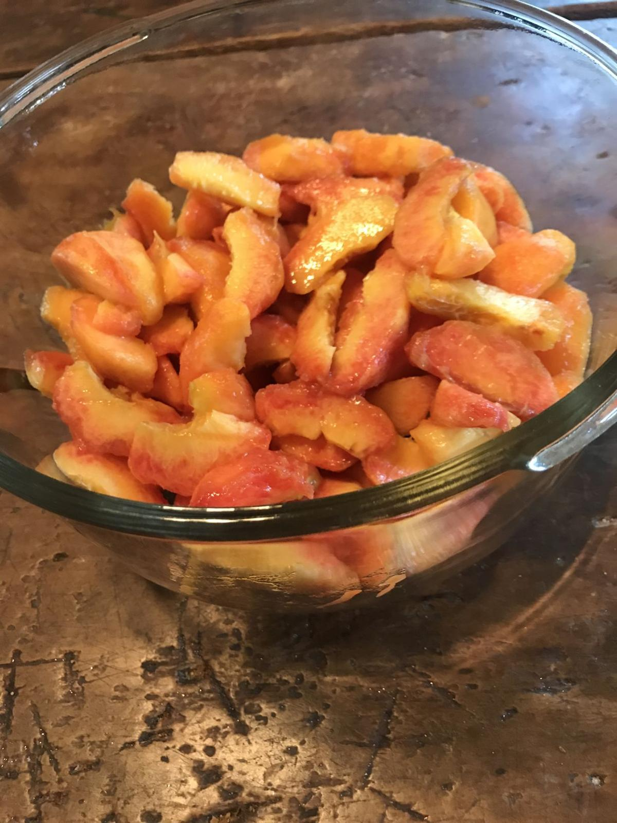 Peeled and sliced peaches