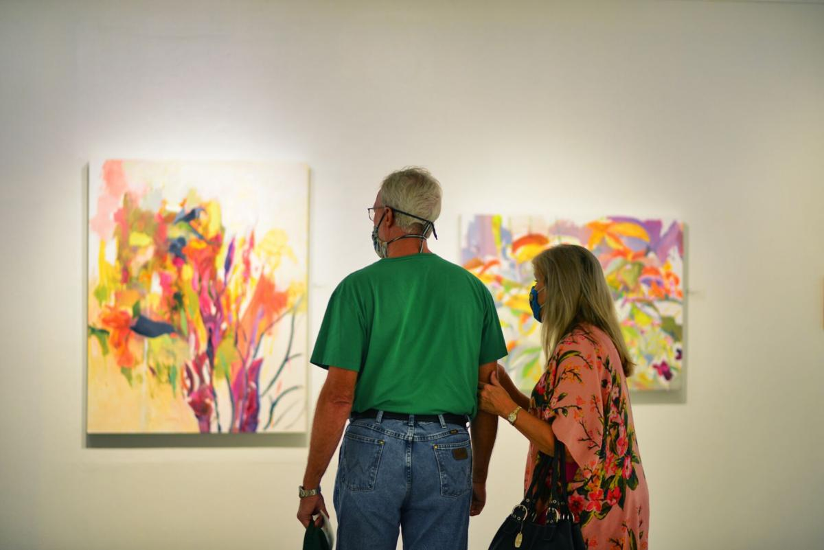 A couple peruses the 'Beyond the Backdoor' exhibit at the Nave Museum.