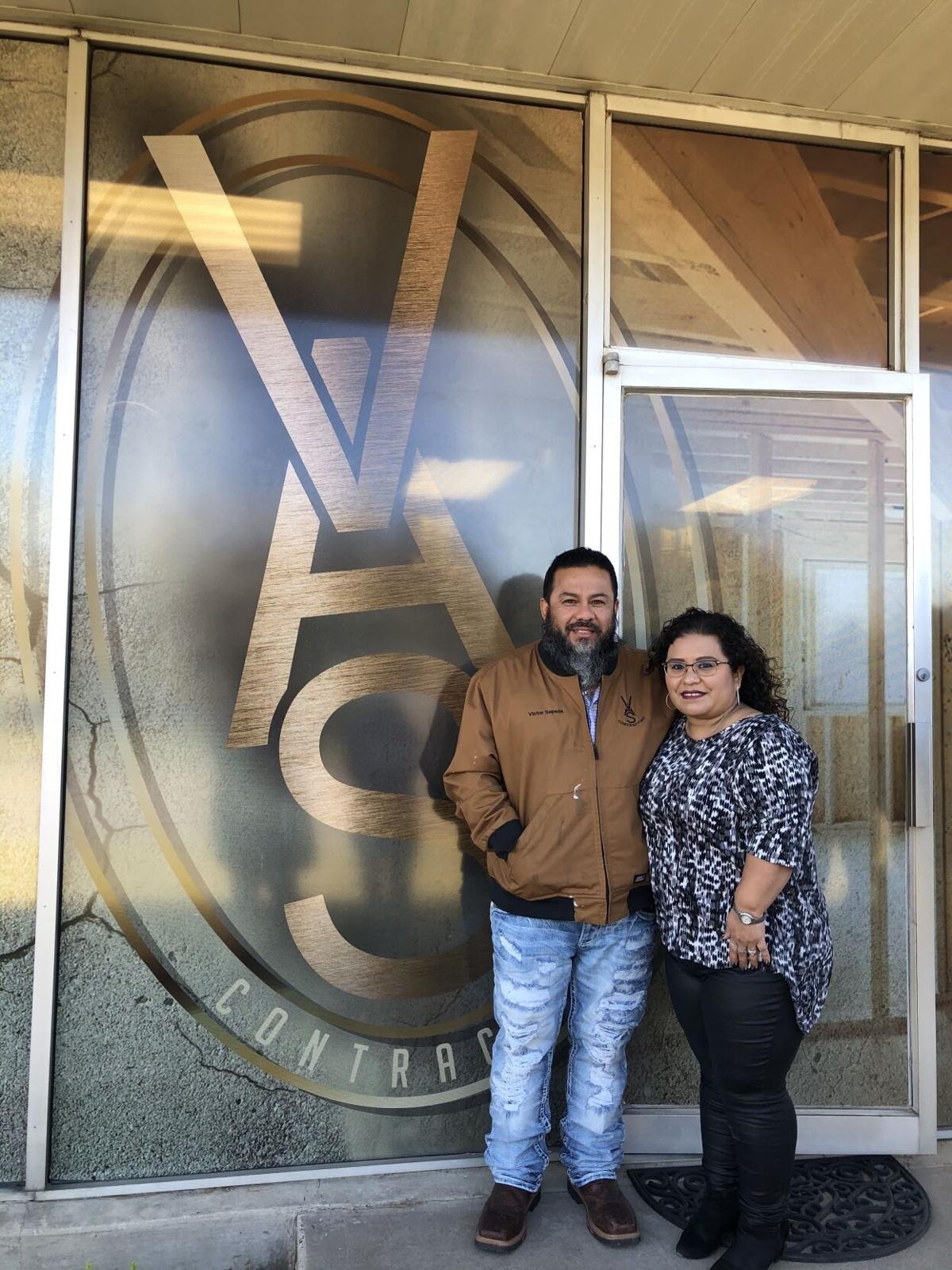 Angela and Victor Sepeda in front of their business, VAS Contracting
