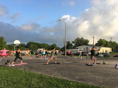Deep breath in: Yoga class brings a moment of peace amid pandemic