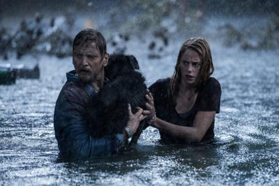 Barry Pepper and Kaya Scodelario in CRAWL from Paramount Pictures.