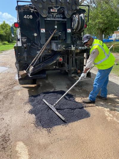 Bryant Stamps pothole repair
