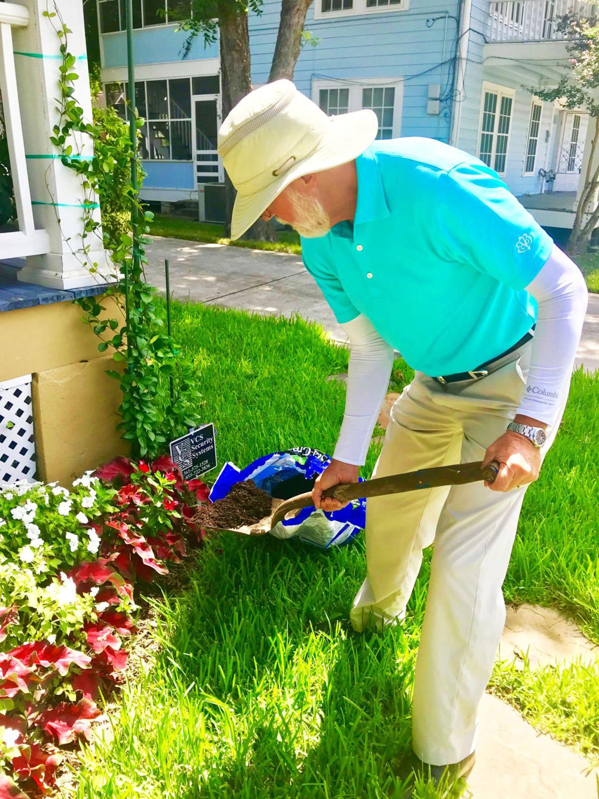 John Elmore working with shovel
