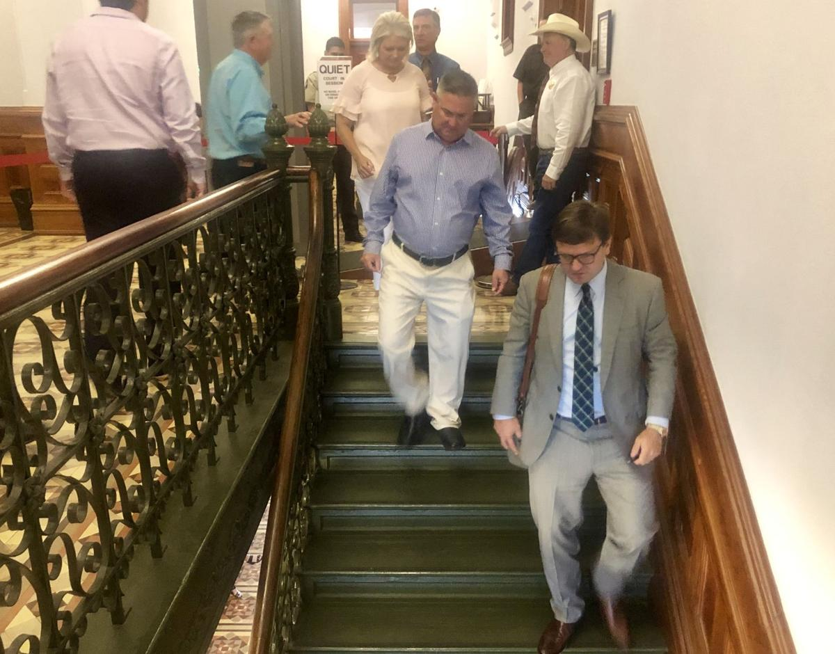 Hallettsville high baseball coach Calvin Cook leaves the courtroom