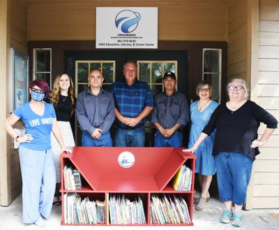 VC donates tiny library to Crossroads Business & Education Connection