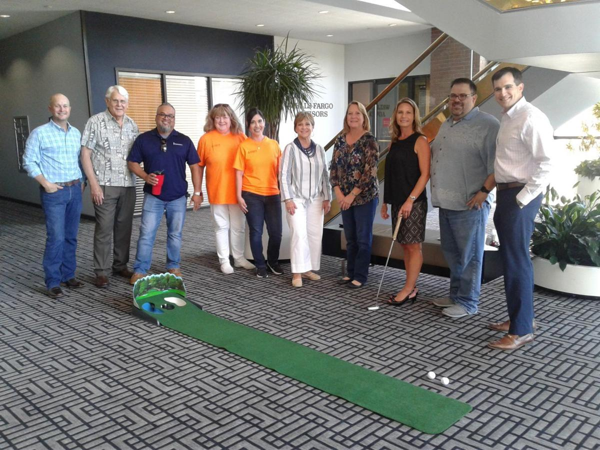 Participants in putting contest