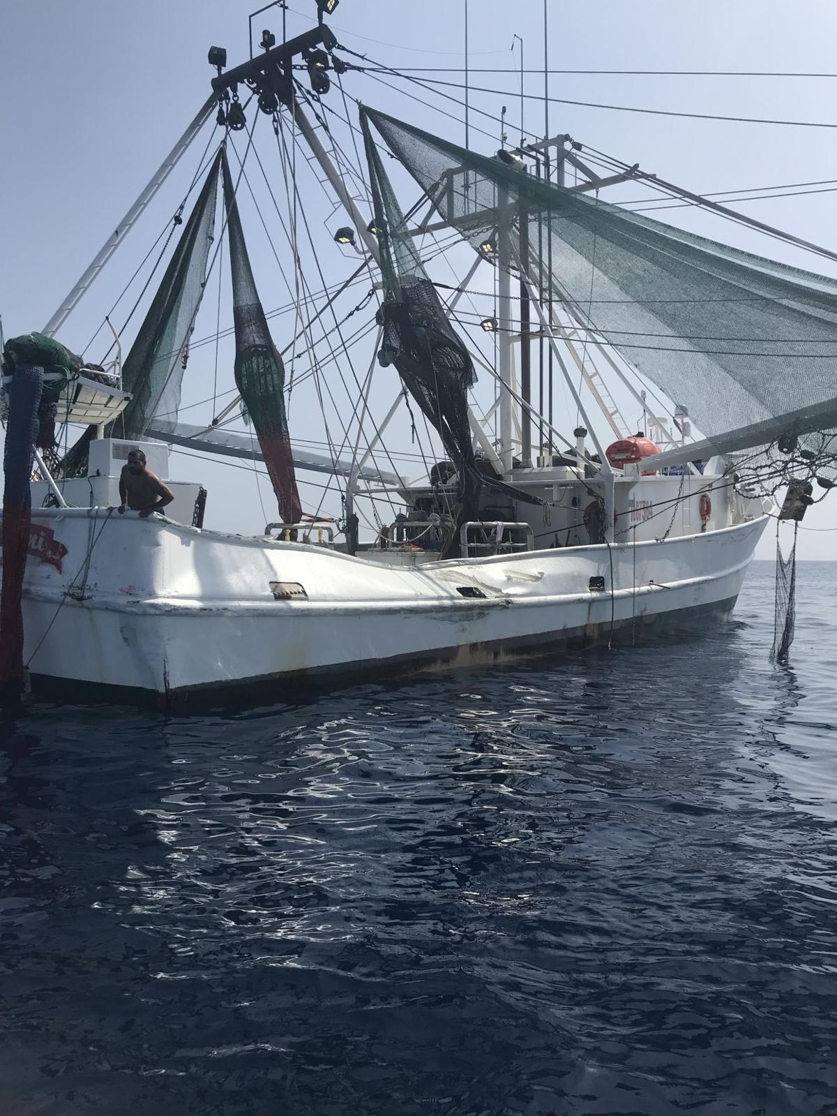 High-dollar sports fishing boat crashes into shrimping boat, sinks