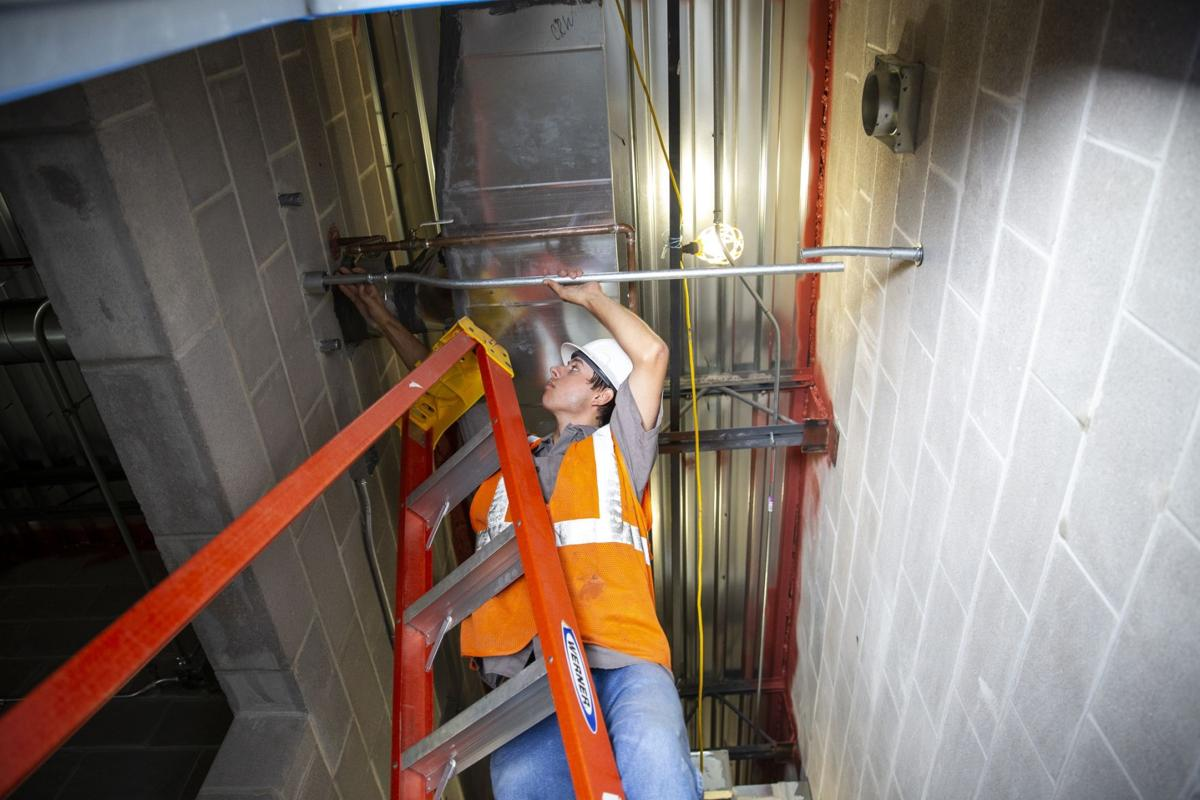 Electrical apprentices work on school expansion