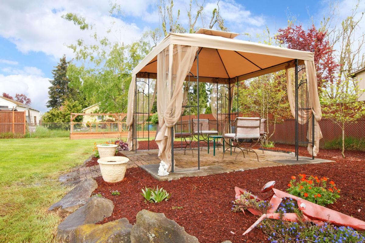Add interest to your yard with outdoor structures   Home And Garden ...