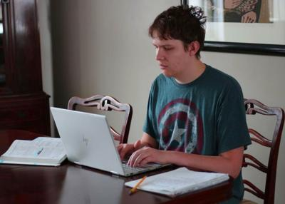 Students taking online classes from home