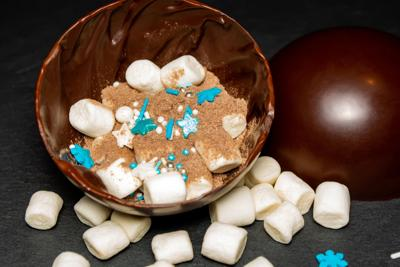 chocolate balls with cocoa and marshmallows in New Year's decoration