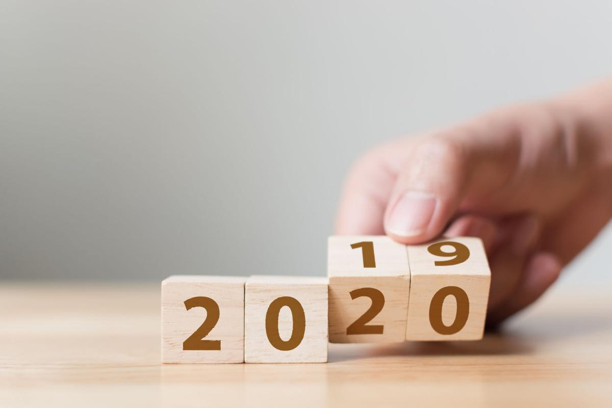 New year 2019 change to 2020 concept. Hand flip over wood cube block