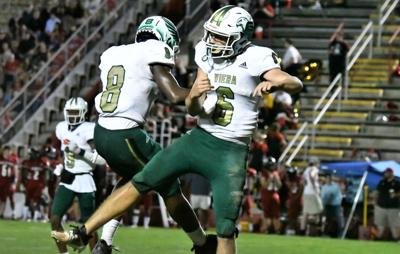 Simms throws for three TDs as Hawks defeat Baker County