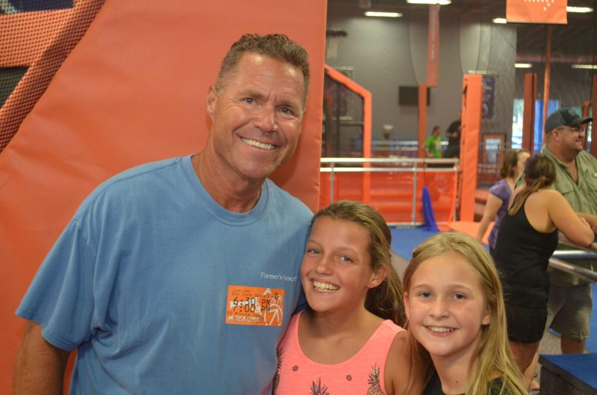 Visitors bounce into Sky Zone for a preview of trampoline park