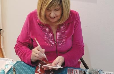 Artist designs, donates greeting cards to bring good cheer