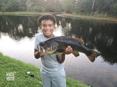 11-year-old hooked on fishing during pandemic snags big bass