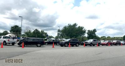 Traffic builds as drivers line up for COVID-19 vaccinations