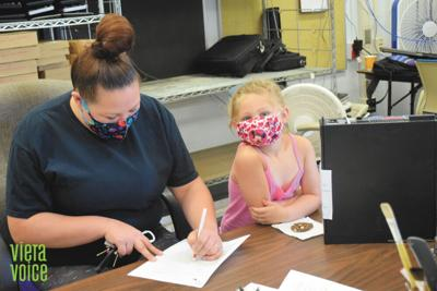 Volunteers help students advance with donated computers
