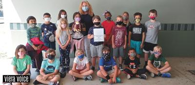 Second graders adopt zoo eagle to honor military