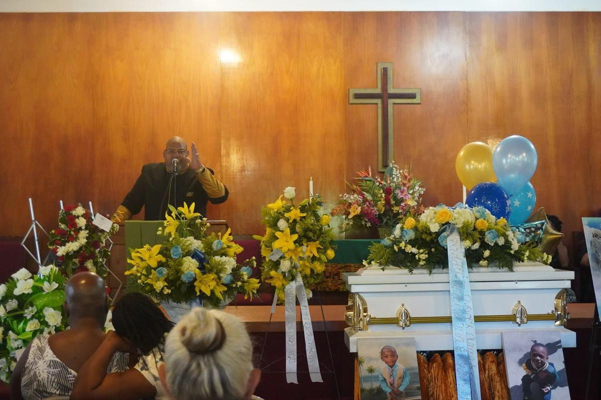 Community comes together to mourn slain 4-year-old Aaron Benjamin