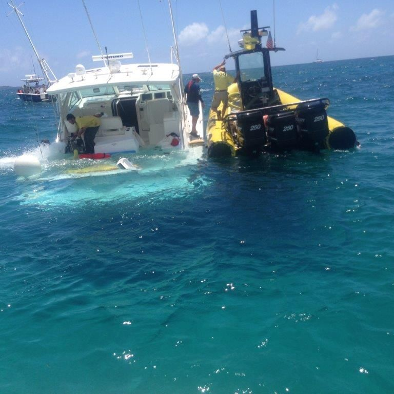 Sea Tow Pulls Sinking Boat Off Reef