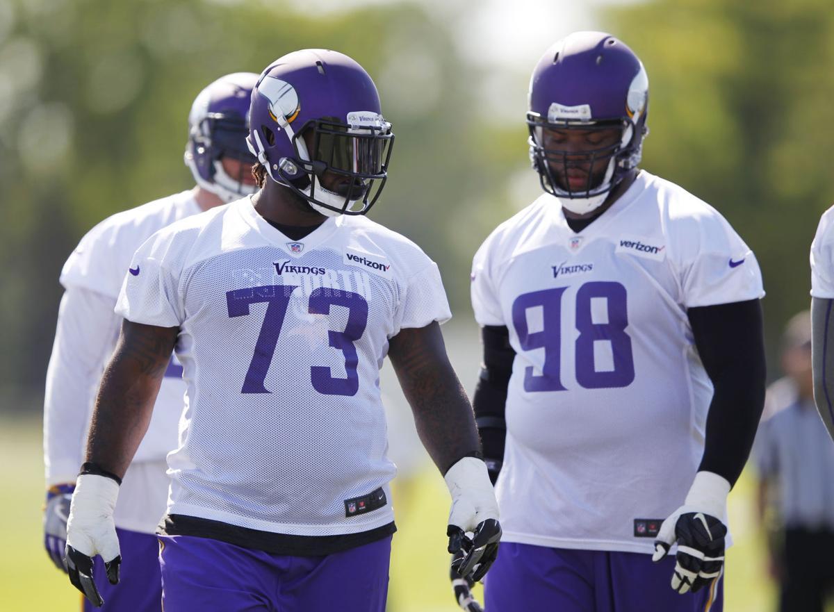 Vikings defensive tackles Sherrif Floyd Linval Joseph buddy up