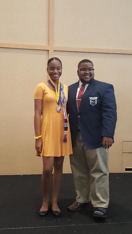 2017-18 Southern Region Vice President Keenan Carter presents Una Alexander  with the first place medal at the FBLA Middle Level Awards of Excellence  Program ...