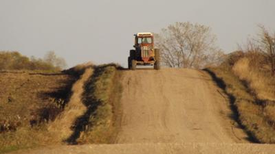 Lone Tractor at Harvest Time