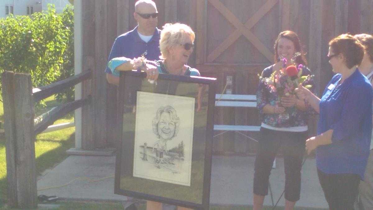 Coni receives her caricature