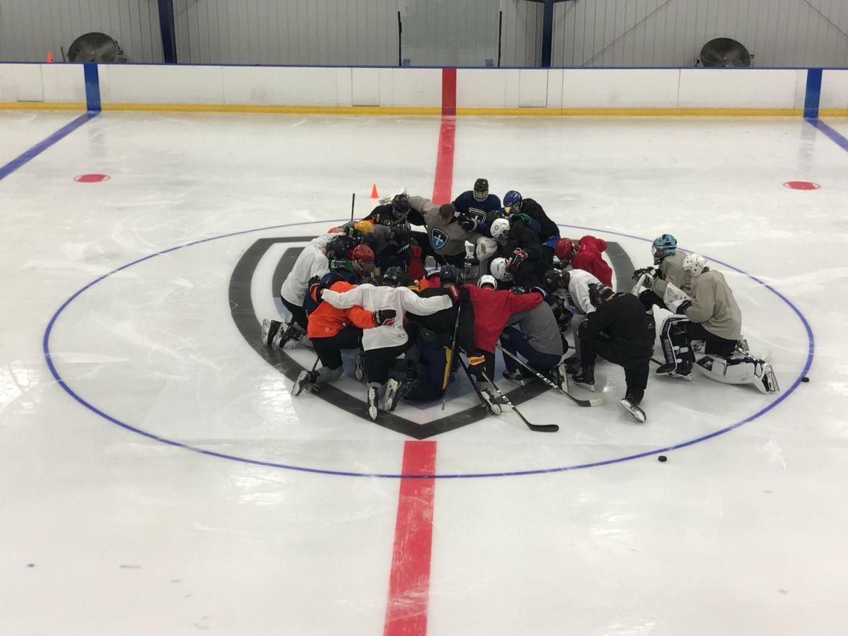 Knights gather at center ice for prayer