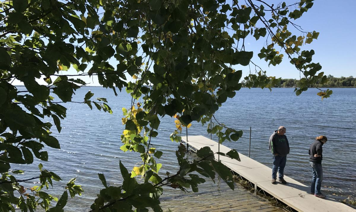 Haggenmiller and Derks pause at a public boat launch